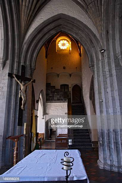 Interior view of the church at the Holy Cross Abbey with Priest in doorway The picturesque ruins of the monastery are situated on the right bank of...