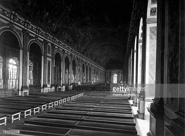 Interior view of the Hall of Mirrors showing the arrangement of tables prepared for the signing of Peace Terms Versailles France June 1919 US Army...