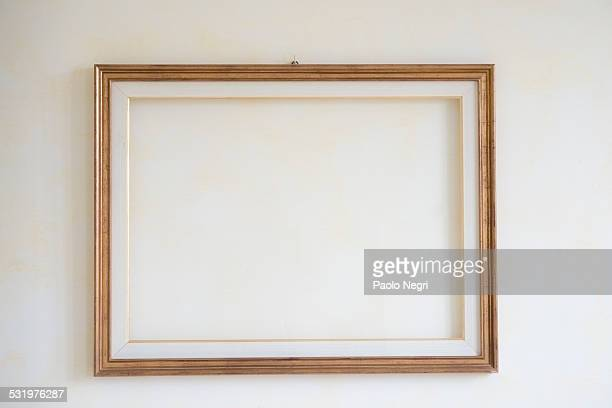 Interior wall with blank picture frame