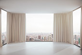 Empty concrete interior with curtains and city view. 3D Rendering