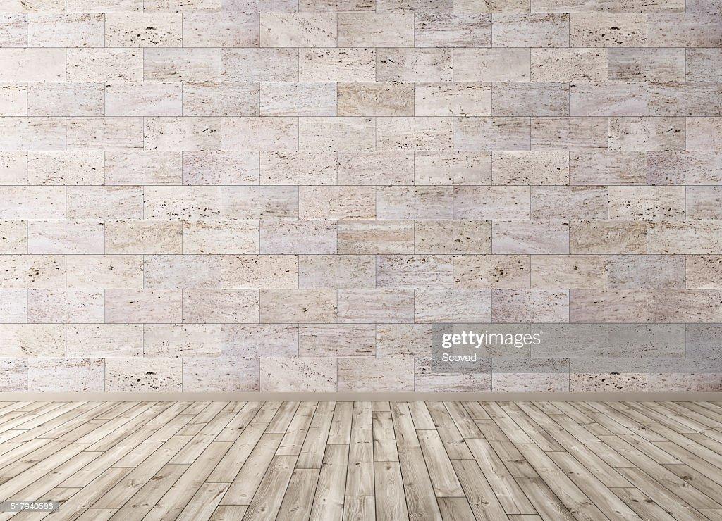 Interno con piastrelle in pietra parete e pavimento in legno