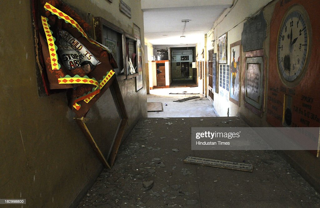 Interiors of Government Boys Senior School, Chittaranjan Park vandalized after students protest against the Principal over injury of class 4th student Roshan Lama on October 3, 2013 in New Delhi, India. 11 year old boy Roshan Lama is battling for life at AIIMS Trauma Centre after a javelin, thrown by a senior student during a practice session, pierced his skull at a school playground in CR Park area of south Delhi two days ago.