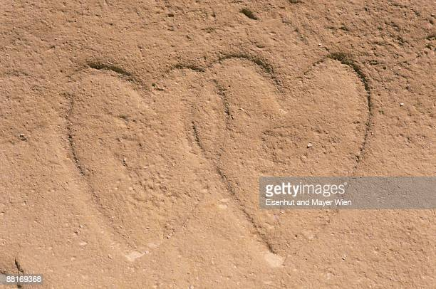 Interlocking hearts carved into ground