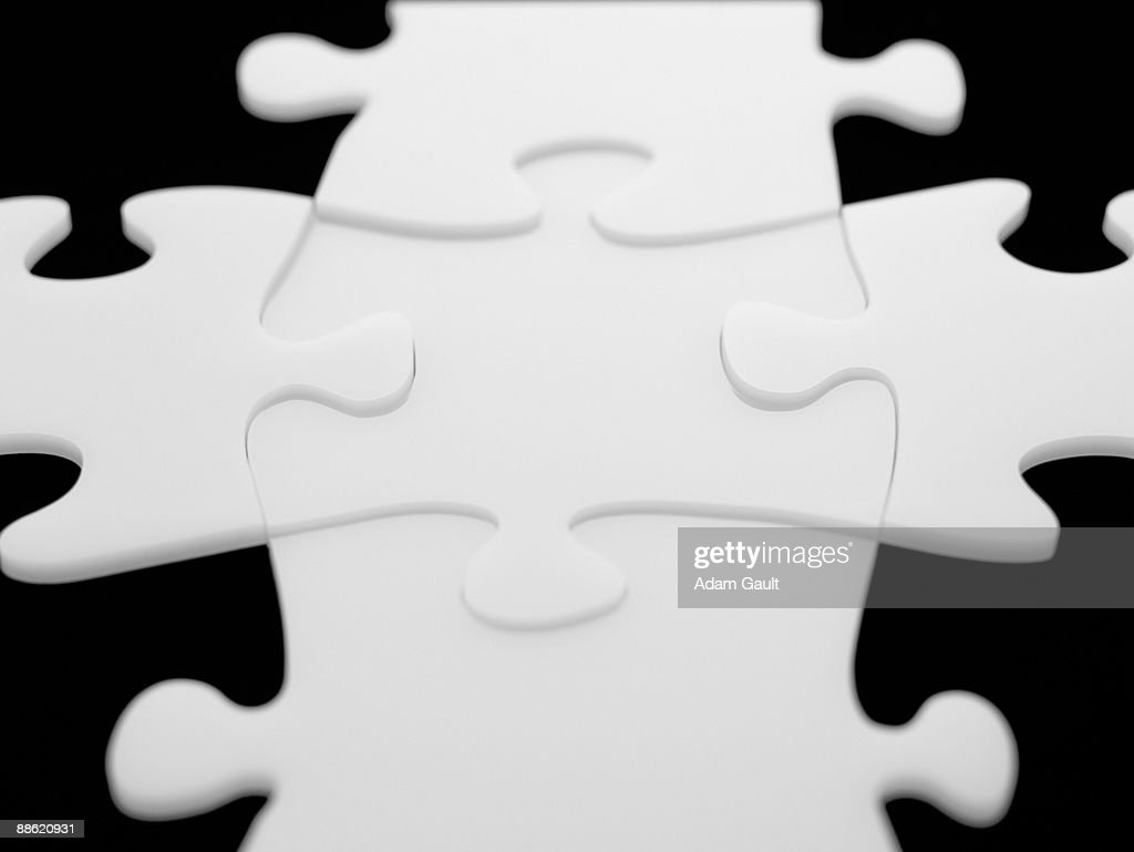 Interlocking puzzle pieces : Stock Photo