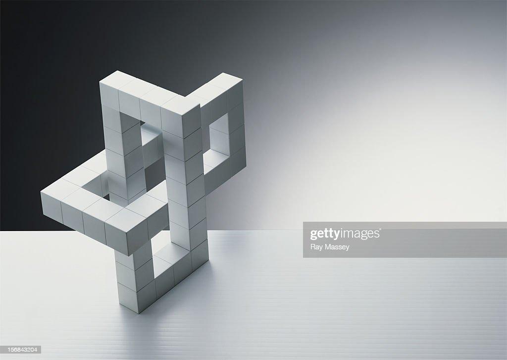 Interlocking white cubes