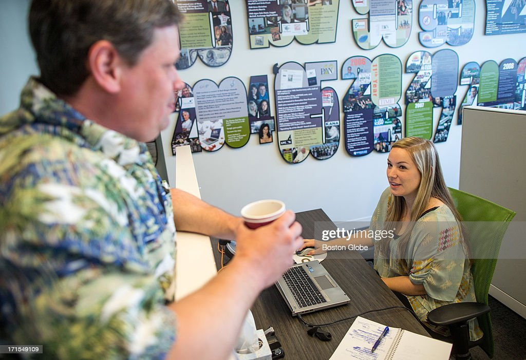 Intern Lindsay Boegel, right, 23, speaks with Vice President Gene Carozza at PAN Communications in Boston.