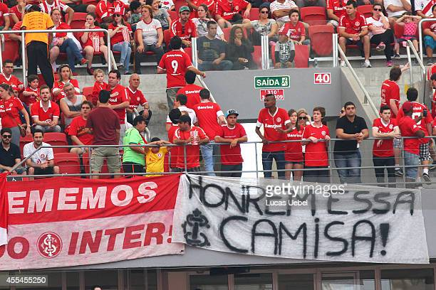 Internacional fans protest against the last results of their time with flag writting 'honour this shirt' before the match between Internacional and...