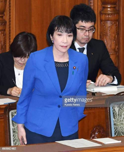 Internal affairs minister Sanae Takaichi bows in appreciation during a House of Councillors plenary session in Tokyo on June 9 after a bill was...