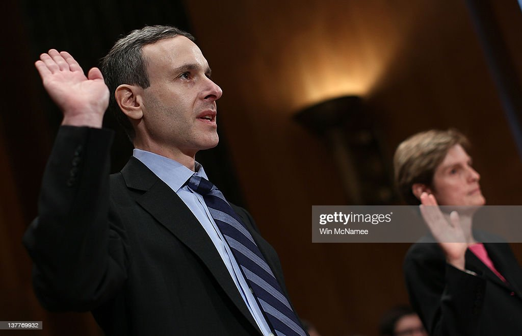Internal Revenue Service Commissioner Douglas Shulman and Assistant Treasury Secretary for Tax Policy Emily McMahon are sworn in prior to testifying...