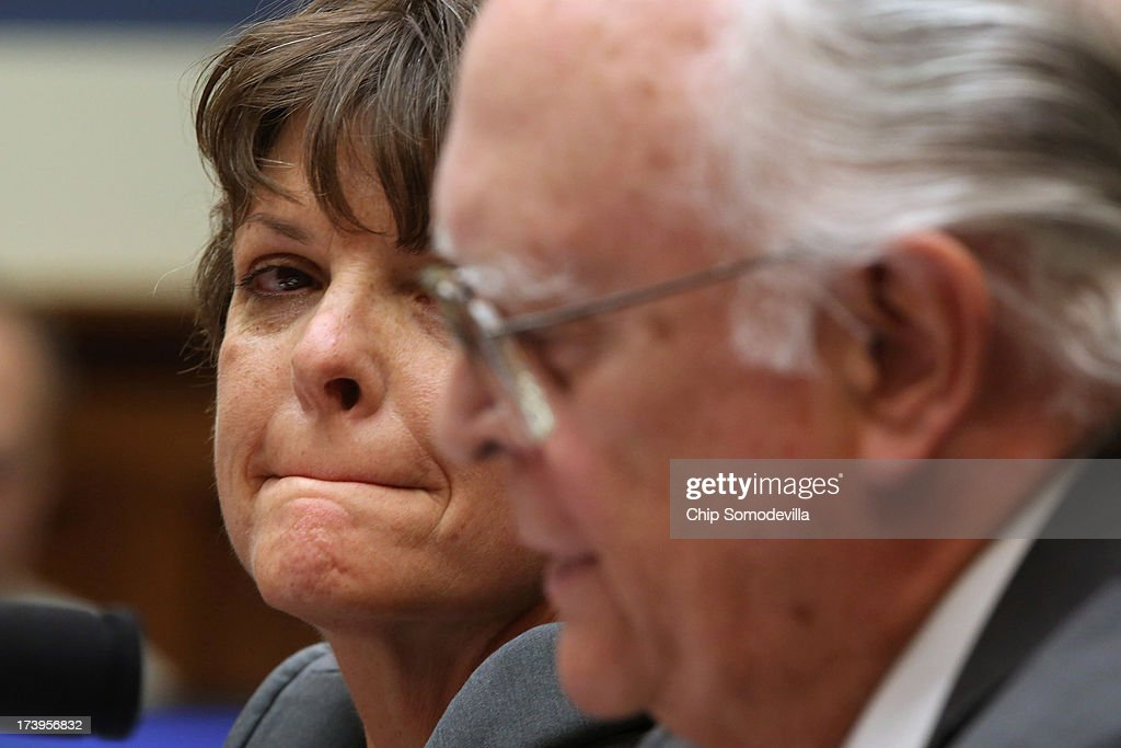 Internal Revenue Service Tax Exempt and Government Entities Division revenue agent Elizabeth Hofacre (L) and retired IRS tax law specialist Carter Hull testify before the House Oversight and Government Reform Committee in the Rayburn House Office Building on Capitol Hill July 18, 2013 in Washington, DC. The witnesses testified as part of the committee's ongoing investigation into claims that the IRS systematically delayed and scrutinized applications for tax exempt status from organizations with the words 'Tea Party' and 'patriot' in their names.