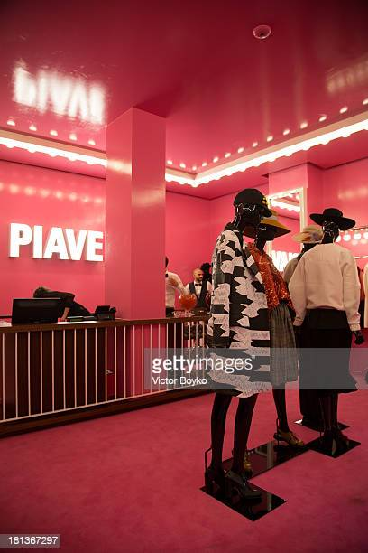 Internal view ofattends opening cocktail of Piave 37 Dolce Gabbana multibrand store as a part of Milan Fashion Week Womenswear Spring/Summer 2014 on...