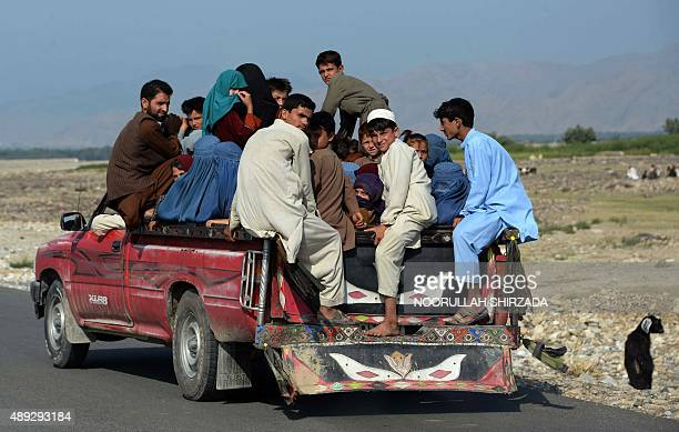 Internally displaced Afghans flee their homes during ongoing clashes between Afghan security forces and militants in Kot district of Nangarhar...