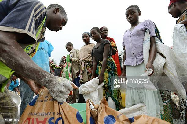 Internally Displaced People wait for their turn during a food distribution program at an IDP camp in Mugunga 15km outside of Goma on May 25 2013 The...