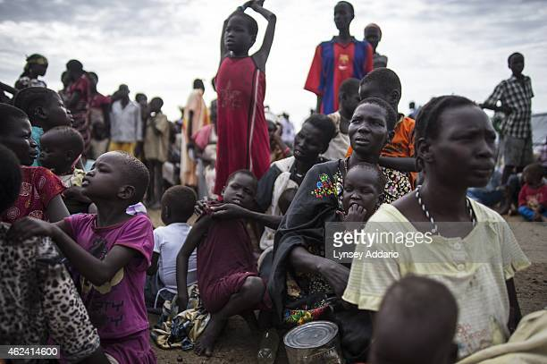 Internally displaced people wait to register for a food distribution at a camp at the base of the United Nations Mission in South Sudan in Bentiu...