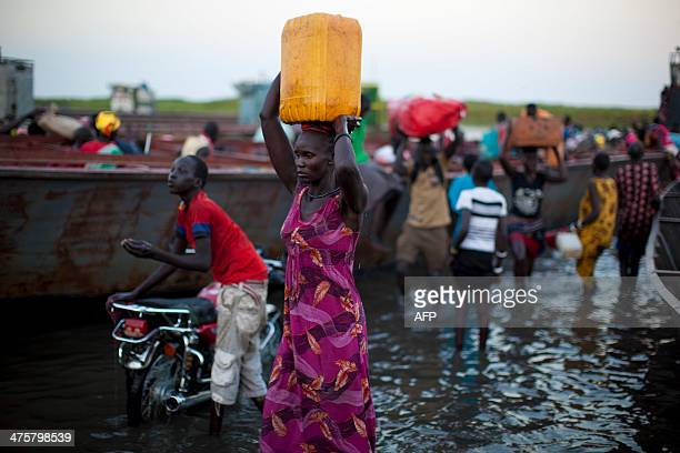 Internally displaced persons cross the Nile river to get to Minkamman on March 1 2014 Khartoum dispatched reinforcements to its front lines on...