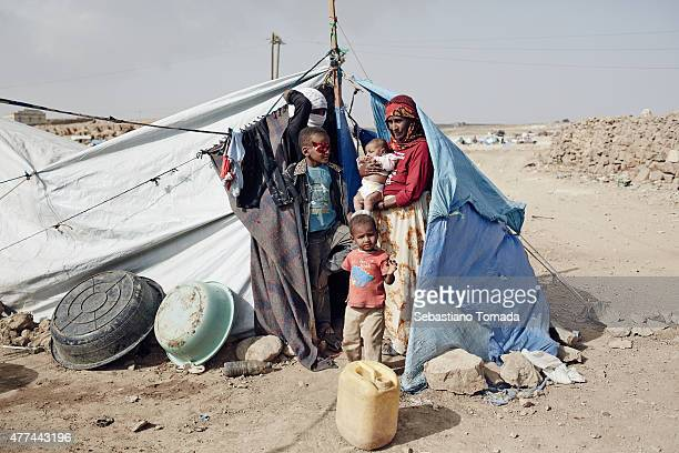 Internally Displaced Persons fleeing the war find basic shelter in a temporary refugee camp bordering the town of Amran Yemen on June 15 in northern...