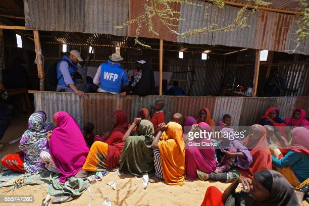 MOGADISHU SOMALIA MARCH 7 2017 Internally Displaced Persons huddle at a World Food Program aid center at the 'KM13' camp on the outskirts of...
