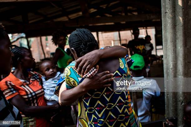 Internally Displaced Persons hug after finding each other at a registration site for IDP's fleeing from the conflict in the Kasai Province on June 6...