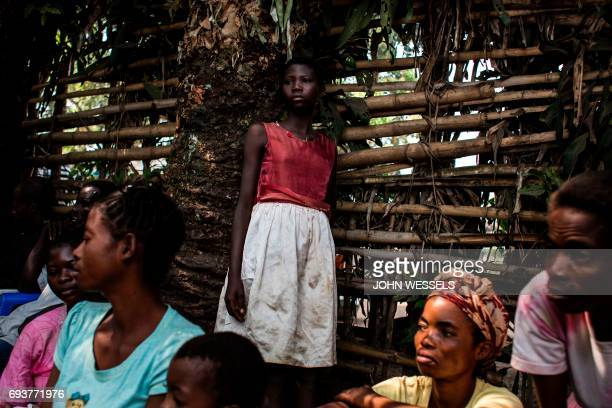 Internally Displaced Persons wait for their daily food ration in a site for IDP's fleeing the conflict in the Kasai Province on June 7 2017 in Kikwit...