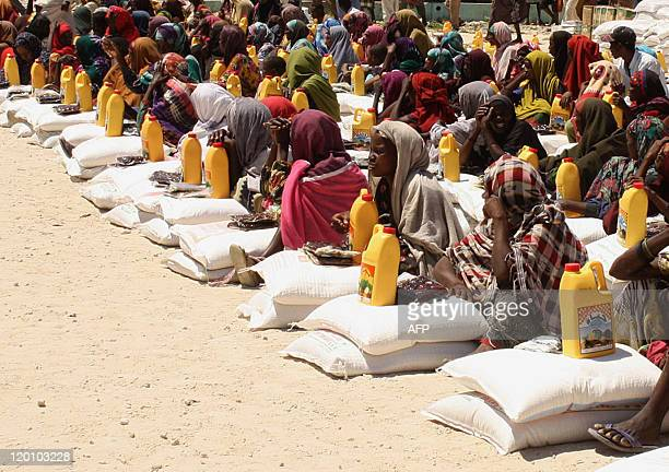 Internally displaced Somali women receive foodaid at a distribution centre in Mogadishu on July 30 2011 Somalia is the Horn of Africa country worst...