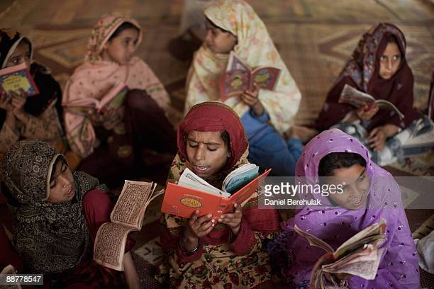 Internally displaced young girls from the Swat valley recite the Koran at a Madrassa in the Shah Mansoor IDP camp on July 1 2009 in Swabi District...