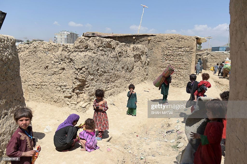 Internally-displaced Afghan children gather at a refugee camp in Kabul on May 31, 2016. The number of people internally displaced by war in Afghanistan has doubled since 2012 to 1.2 million, Amnesty International said on May 31, citing government neglect and a lack of international attention. In its report entitled 'My children will die this winter: Afghanistan's broken promise to the displaced', the rights group warned that a lack of basic services had pushed many of those uprooted from their homes to the brink of survival. / AFP / SHAH