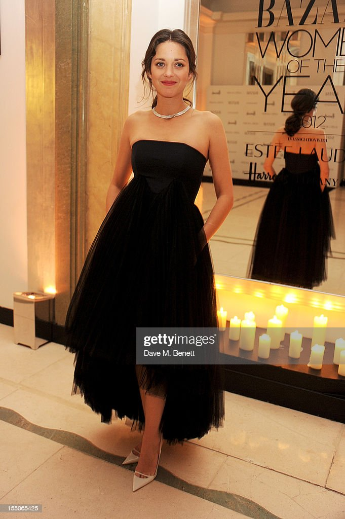 International Actor of the Year Marion Cotillard poses at the Harper's Bazaar Women of the Year Awards 2012, in association with Estee Lauder, Harrods and Tiffany & Co., at Claridge's Hotel on October 31, 2012 in London, England.