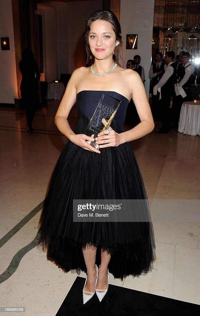 International Actor of the Year winner <a gi-track='captionPersonalityLinkClicked' href=/galleries/search?phrase=Marion+Cotillard&family=editorial&specificpeople=215303 ng-click='$event.stopPropagation()'>Marion Cotillard</a> poses at the Harper's Bazaar Women of the Year Awards 2012, in association with Estee Lauder, Harrods and Tiffany & Co., at Claridge's Hotel on October 31, 2012 in London, England.