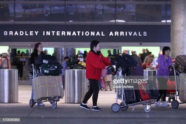 International air travelers arrive at Tom Bradley International Terminal at Los Angeles International Airport on February 19 2014 in Los Angeles...
