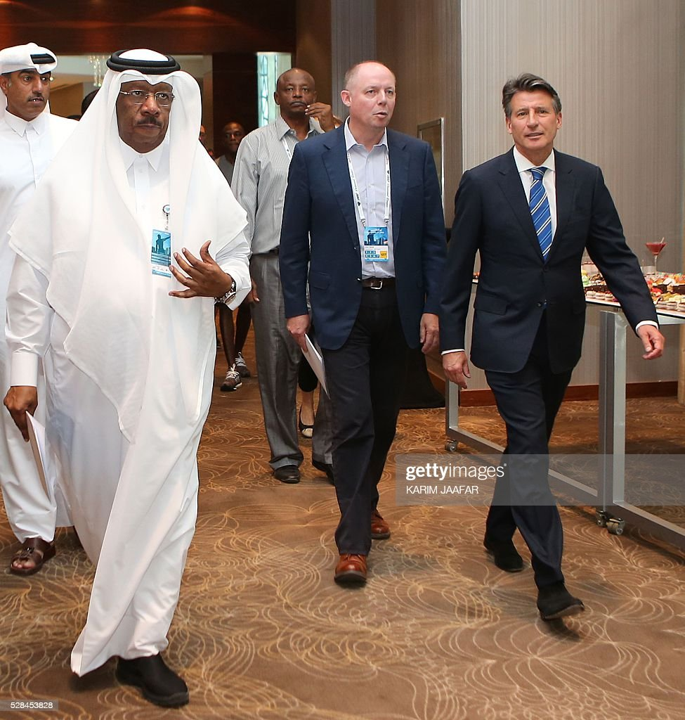 International Association of Athletics Federations (IAAF)'s president Sebastian Coe (R) and Qatar Athletics Federations' president, Dahlan al-Hamad (L), arrive for a press conference in the capital Doha on May 5, 2016, on the eve of the Diamond League athletics meeting. / AFP / KARIM