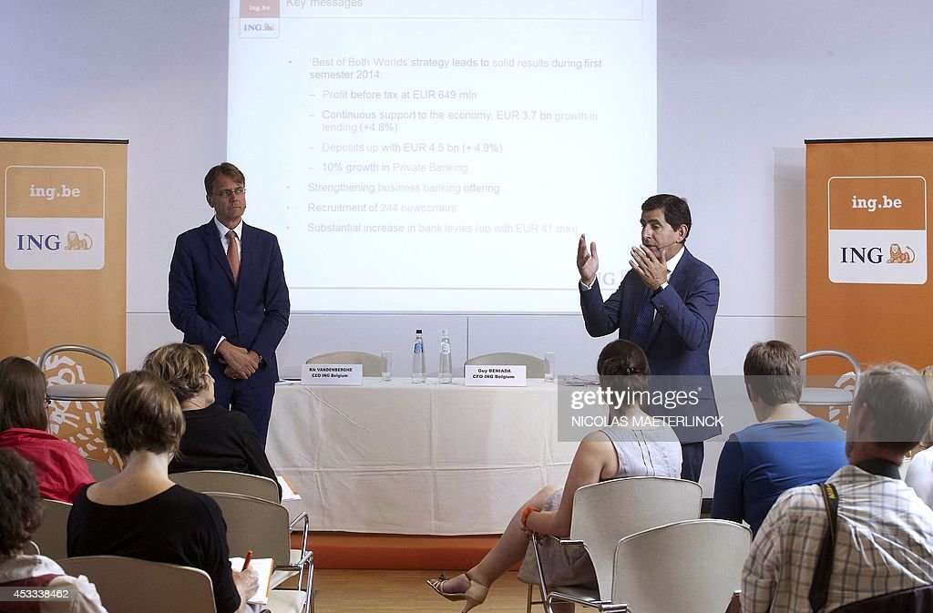 International banking and insurance company ING CEO Rik Vandenberghe (L) and ING CFO Guy Beniada (R) deliver a press conference to present the half-year financial results of ING Belgium at the ING headquarters in Brussels on August 8, 2014. AFP PHOTO / BELGA / NICOLAS MAETERLINCK ** Belgium Out **