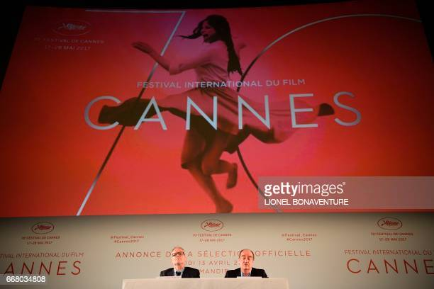 International Cannes Film Festival General Delegate Thierry Fremaux and Festival President Pierre Lescure sitting below the 70th festival's official...