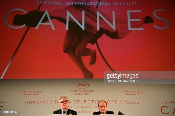 International Cannes Film Festival General Delegate Thierry Fremaux and Festival President Pierre Lescure sitting below the 70th International Cannes...