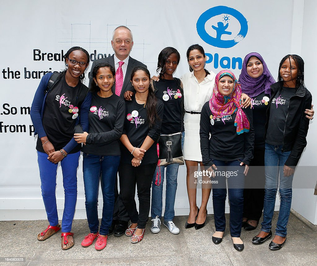 International CEO Nigel Chapman and Actress Freida Pinto pose for a photo with the PLAN International Youth Delegates during the 'Day Of The Girl' Fresco Unveiling With Freida Pinto at UNICEF House on October 11, 2013 in New York City.