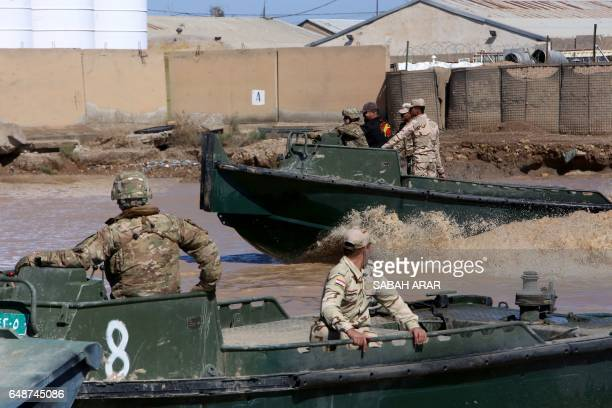 International coalition forces train Iraqi soldiers at the Taji camp north of Baghdad ahead of installing replacement bridges in Mosul on March 6...