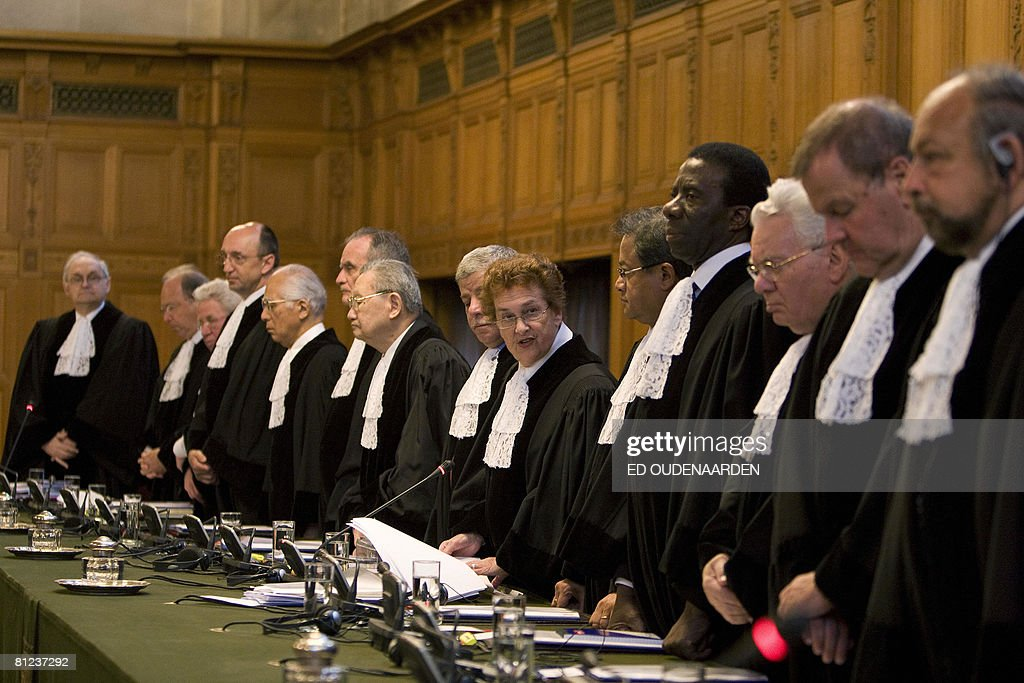 International Court of Justice judges stand on May 26, 2008 with their President Rosalyn Higgens (C) in The Hague at the start of the hearing of a complaint filed in 1999 by Croatia against Serbia, alleging a program of 'ethnic cleansing' during the 1991-1995 war in Croatia was directly controlled from Belgrade. Serbia argued before the UN's highest court on May 26, 2008 that crimes committed in the early 1990s war in Croatia did not amount to an act of genocide as alleged a complaint filed by Zagreb. AFP PHOTO / ED OUDENAARDEN -Netherlands out - Belgium out-