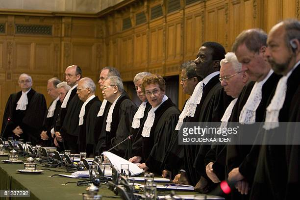 International Court of Justice judges stand on May 26 2008 with their President Rosalyn Higgens in The Hague at the start of the hearing of a...