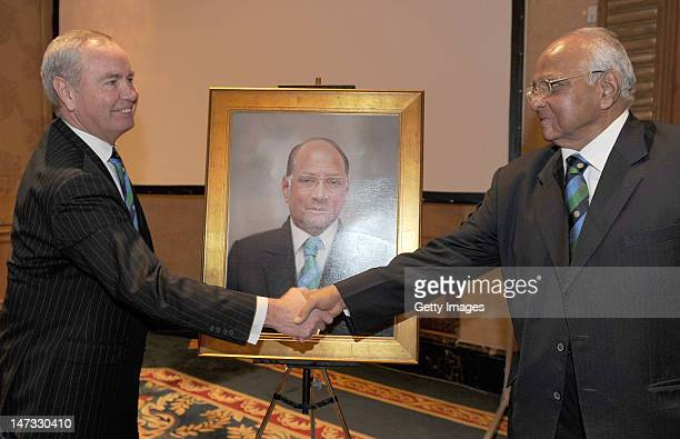 International Cricket Council President Sharad Pawar greets the new ICC President Alan Isaac during the ICC Annual Conference held at the ShangriLa...