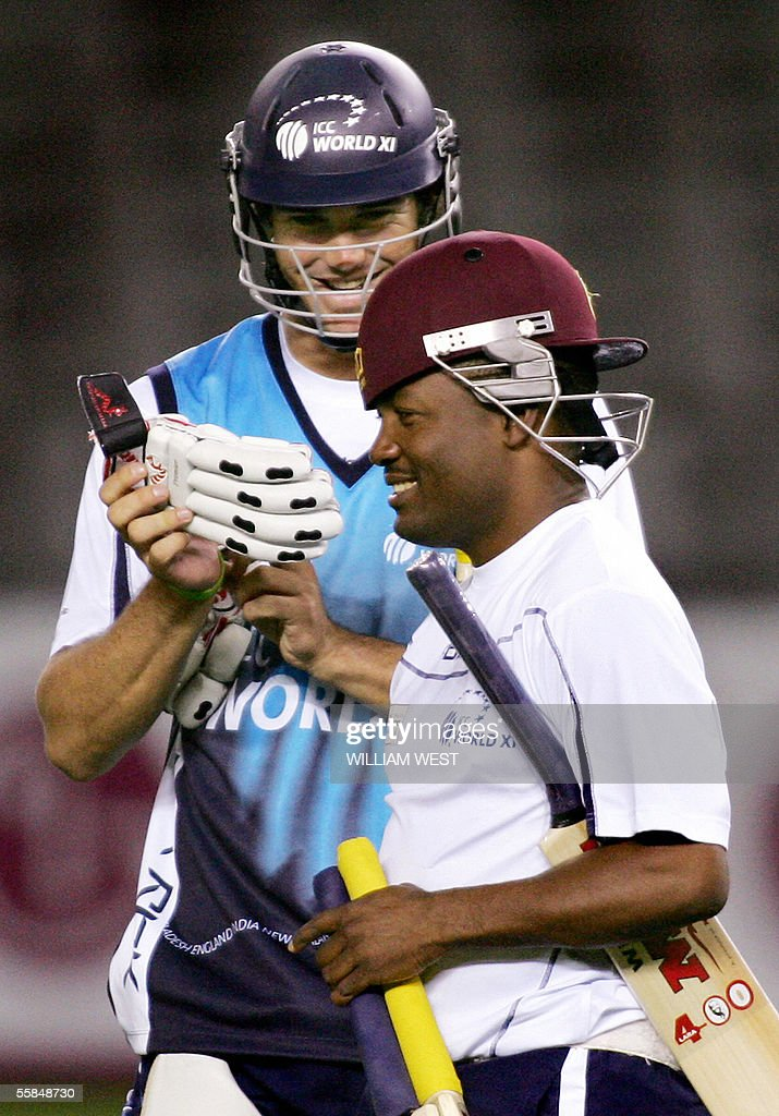 International Cricket Council (ICC) World XI cricket team batsman Brian Lara of the West Indies (R) wears his helmet backwards as teammate <a gi-track='captionPersonalityLinkClicked' href=/galleries/search?phrase=Kevin+Pietersen+-+Cricket+Player&family=editorial&specificpeople=202001 ng-click='$event.stopPropagation()'>Kevin Pietersen</a> of England (L) laughs during training, in Melbourne 04 October 2005. The ICC World XI will play three one-day matches against Australia under a closed roof in the 50,000 seater Docklands Stadium before moving to Sydney where they will play a six-day Test Match. AFP PHOTO/William WEST