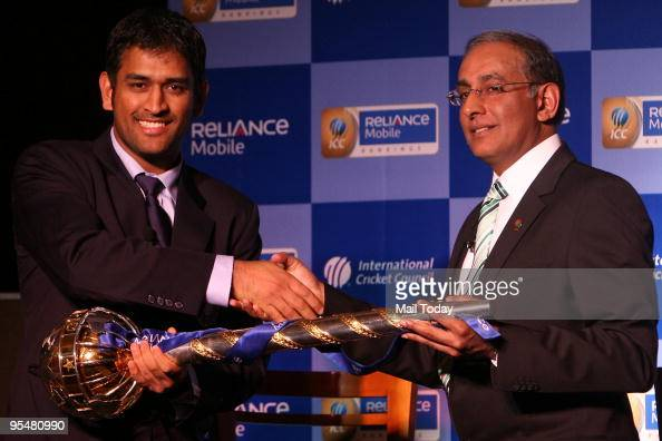 International Cricket Council's chief executive Haroon Lorgat right presents ICC test championship mace to Indian cricket captain Mahendra Singh...