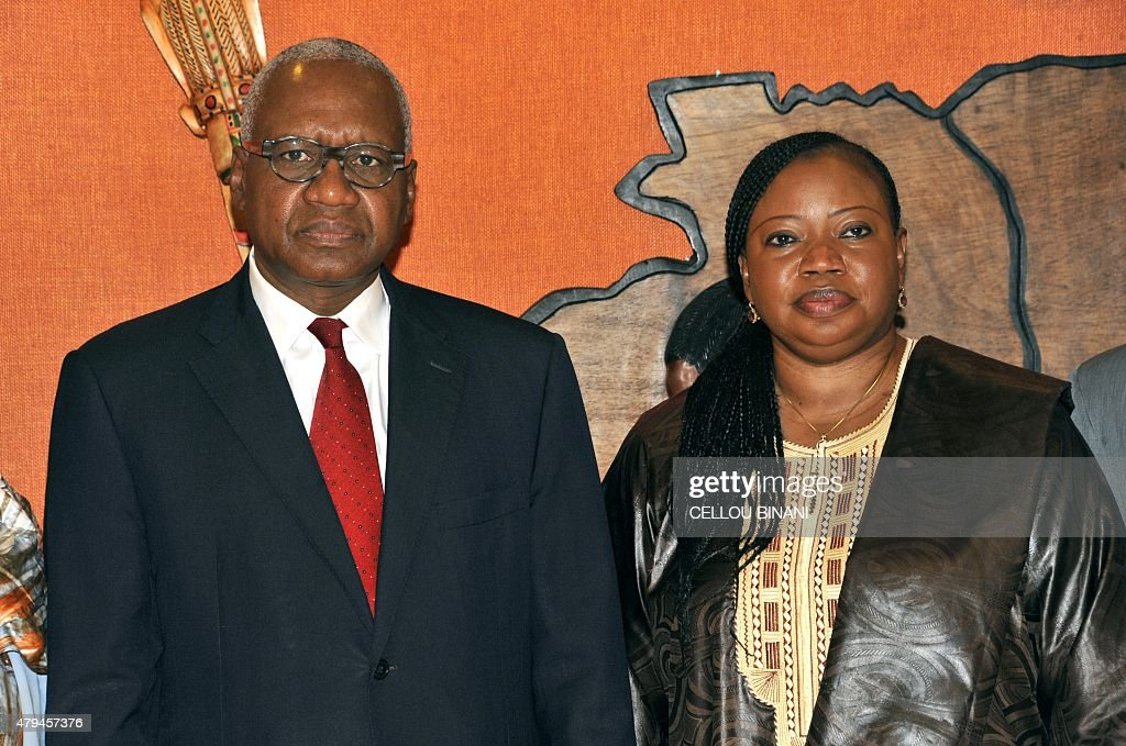 International Criminal Court (ICC) chief prosecutor <a gi-track='captionPersonalityLinkClicked' href=/galleries/search?phrase=Fatou+Bensouda&family=editorial&specificpeople=802492 ng-click='$event.stopPropagation()'>Fatou Bensouda</a> (R) poses with Guinean Justice Minister Cheick Sako during a meeting on July 4, 2015, in Conakry, on the last day of her three-day visit in Guinea for an update on investigation of 2009 massacre of 157 people during an opposition rally in Conakry. AFP PHOTO / CELLOU BINANI