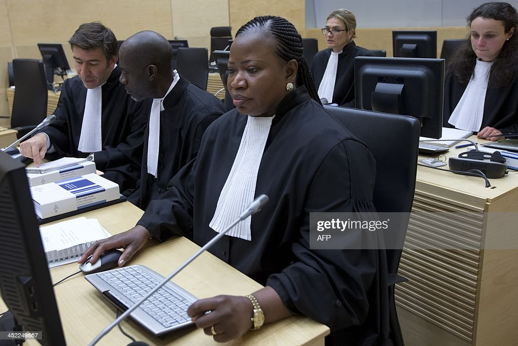 International Criminal Court (ICC) Chief Prosecutor <a gi-track='captionPersonalityLinkClicked' href=/galleries/search?phrase=Fatou+Bensouda&family=editorial&specificpeople=802492 ng-click='$event.stopPropagation()'>Fatou Bensouda</a> (R) sits next to ICC Senior Appeals Counsel Fabricio Guariglia (L) and ICC counsel Kweku Vanderpuye (C) on November 27, 2013 before the start of the trial of Congolese Vice President Jean-Pierre Bemba and two close associates at the ICC in The Hague on suspicion of tampering with witnesses in his war crimes trial. Bemba faces three war crimes counts and two counts of crimes against humanity before the ICC in a case related to widespread atrocities committed by his DR Congo-based Movement for the Liberation of Congo (MLC) troops in the Central African Republic between October 2002 and March 2003. AFP PHOTO / POOL / PETER DEJONG - netherlands out -