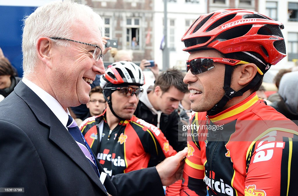 International Cycling Union (UCI) chief Pat McQuaid (L) speaks with Spain's Alberto Contador prior to the start of the Men's Elite Road race World Championships on September 23, 2012 in Maastricht.