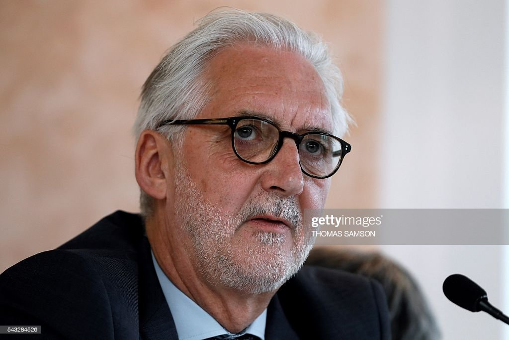 International Cycling Union (UCI) president Brian Cookson looks on during a press conference on mechanical fraud, in Paris, on June 27, 2016. Thermal cameras will be used in this year's Tour de France to fight against motor cheats, French Minister of State for Sport Thierry Braillard announced on Monday. The cameras, which can detect a motor in a bicycle, have been developed by the Atomic Energy Commission (CEA) at the request of the French government. / AFP / Thomas SAMSON