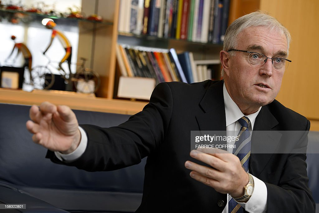 International Cycling Union (UCI) president Pat McQuaid speaks during an interview with AFP journalists on December 13, 2012, at the World cycling governing body's headquarters in Aigle, western Switzerland.