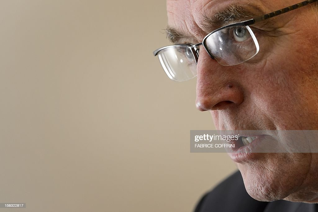 International Cycling Union (UCI) president Pat McQuaid speaks during an interview with AFP journalists on December 13, 2012, at the World cycling governing body's headquarters in Aigle, western Switzerland. AFP PHOTO / FABRICE COFFRINI