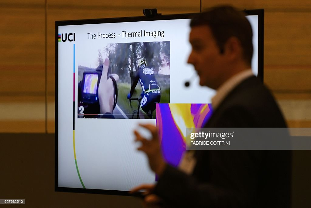 International Cycling Union (UCI) technical manager Mark Barfield speaks during a demonstation on testing technological fraud and detecting the presence of a motor inside the frame at the UCI headquarters in Aigle, western Switzerland, on May 3, 2016. The tablet scans a bicycle with magnetic resistance technology, testing the frame and wheels in less than a minute in order to detect mechanical doping during cycling races. / AFP / FABRICE