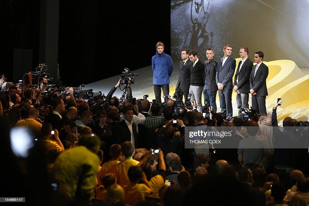 International cyclists, Britain's Bradley Wiggins, Australia's Cadel Evans, Britain's Mark Cavendish, Belgium's Philippe Gilbert, US Tejay Van Garderen, Britain's Chris Froome and Spain's Alberto Contador stand on stage during the unveiling of the 2013 cycling classic Tour de France route on October 24, 2012 in Paris. The 100th edition of the Tour will take place from June 29 to July 21 and will start in Corsica for the first time in its history.