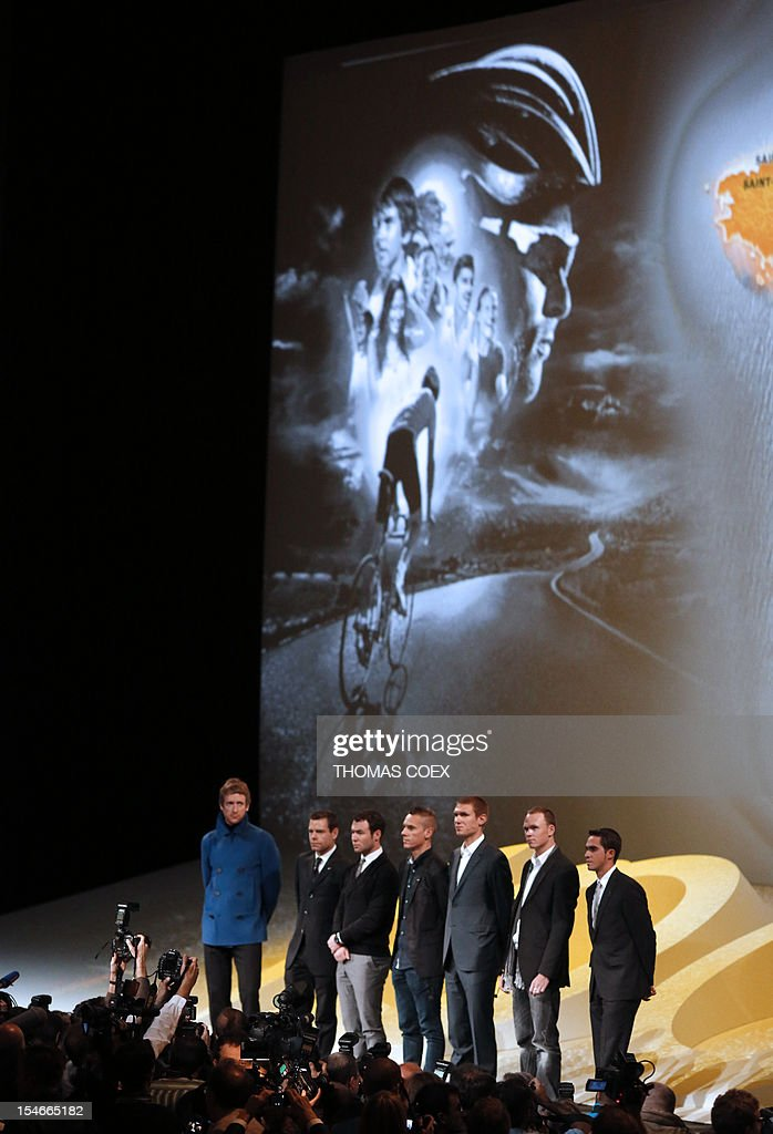 International cyclists, Britain's Bradley Wiggins, Australia's Cadel Evans, Britain's Mark Cavendish, Belgium's Philippe Gilbert, US Tejay Van Garderen, Britain's Chris Froome and Spain's Alberto Contador stand on stage during the unveiling of the 2013 cycling classic Tour de France route on October 24, 2012 in Paris. The 100th edition of the Tour will take place from June 29 to July 21 and will start in Corsica for the first time in its history. AFP PHOTO THOMAS COEX