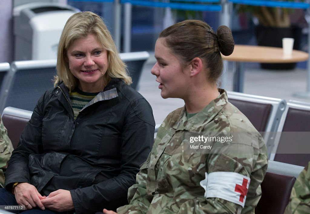 International Development Secretary Justine Greening chats with British Army medics board as they wait to board an aircraft as they depart for Sierra Leone at RAF Brize Norton on October 21, 2014 in Brize Norton, England. The medics from Catterick based 35 Squadron from 5 Medical Regiment, will man the Ebola Training Academy, instructing the health care workers who will be working in the five Ebola Treatment Units the UK is currently building.